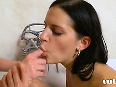 Two lesbians dildoing in the tub