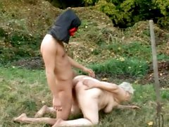 Fat granny is sucking big dick outdoors