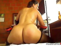This horny Colombian MILF loves riding her dildo and she's hella thick