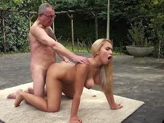 A goddess blonde babe gets scored in multiple poses outdoors by a grandpa