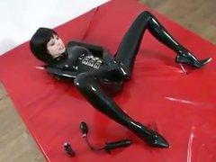 Mia Lana in latex catsuit
