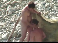 Guys sucking on the beach