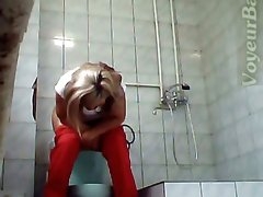 Blonde adorable lady in red panties filmed on hidden cam in the toilet