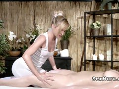 Blonde masseuse relaxing pale redhead