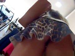 Woman in leopard pattern short skirt