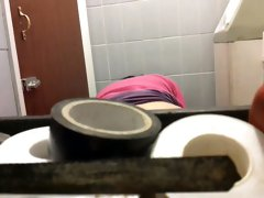 The ass of amateur spied while her pissing on toilet