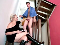 Mom in glasses fuck on the stairs with young dude