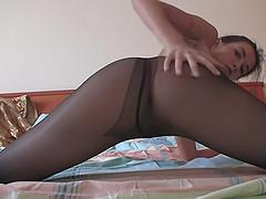 Hot girls puts on sexy black pantyhose