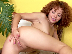 Suny is a honey with curly hair who loves masturbatin with a toy