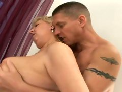 Huge boobed granny fucked brutally in a doggy position