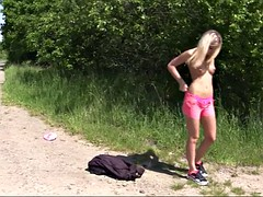 teen blonde babe gets naked on a side of a road for a solo game