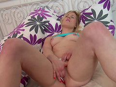 Vivacious blonde likes to finger her wet cunt on the sofa