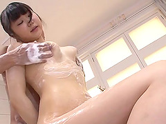 Soapy natural tits and cunt on the Japanese babe
