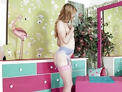 Sweet blonde teen strips and plays in sexy pink stockings