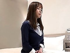 Japanese brunette MILF lifts her legs up to get her pussy toyed with