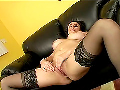 Sex bomb in lovely stockings widens her legs for a lucky stud