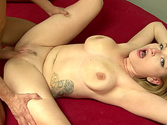 Blonde cougar with great juggs getting her wet pussy licked and fingered