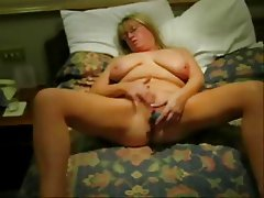 See my busty wife masturbating on bed