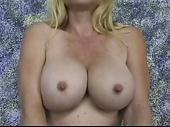 Mature blonde with nice big tits spreads her pussy and toys it for the camera
