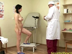 Old pervert plays gynecologist with a busty teen