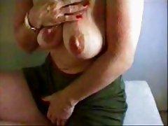 Hot granny rubbing her giant clitoris